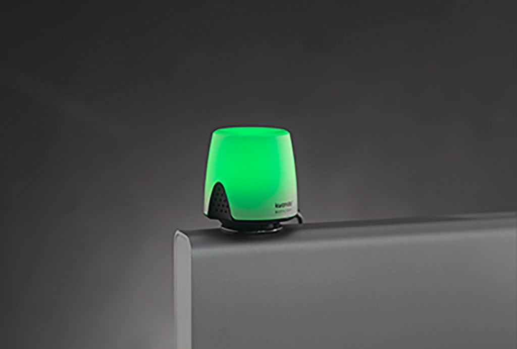 Green kuando Busylight Omega on top of a desktop
