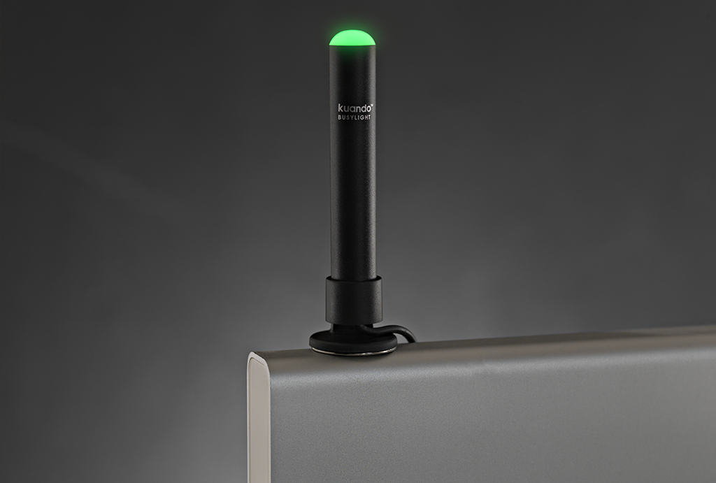 Grren alpha busylight on top of a desktop